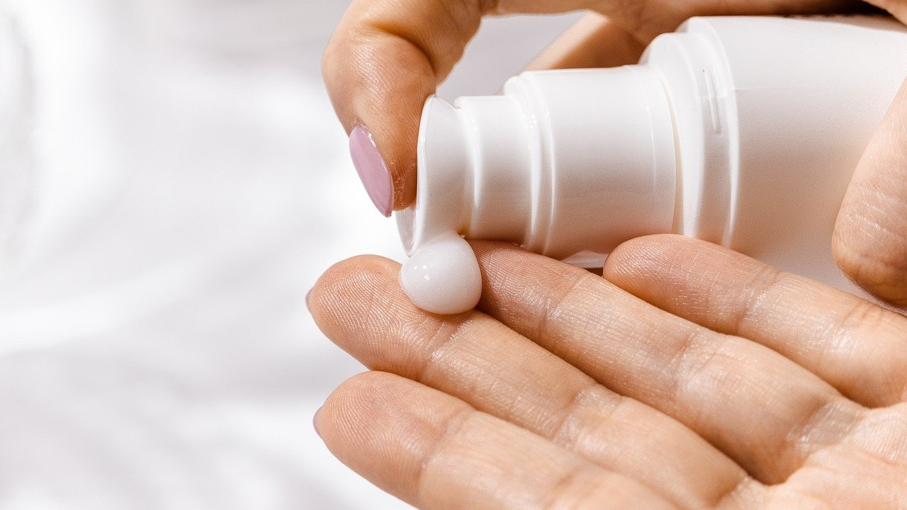 applying lotion to hand