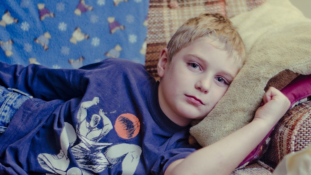 White young boy relaxing on sofa